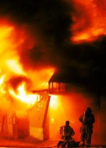 Bowling Green, Ky., fire fighters battle an early moring blaze in an abandoned building on Boatlanding Road.