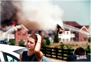 Wilkinson Trace Apartments residents and newlyweds Rachel, left, and her husband Shane Smith of Bowling Green, Ky., watch as fire fighters battle a 3 alarm blaze which destroyed the building.