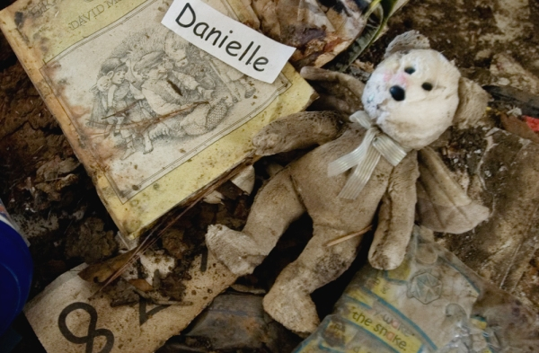 A child's Teddy Bear lies in a hallway of the Charles B. Murphy Elementary School in debris left by Hurricane Katrina sixths months earlier.